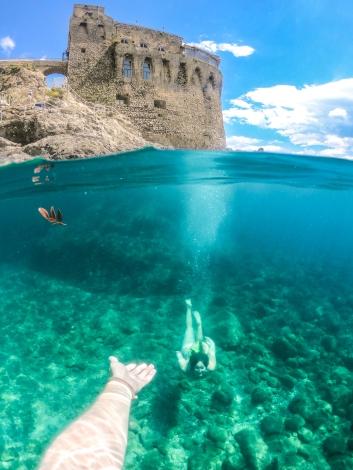 N reaching out to C under Mediterranean-2.jpg